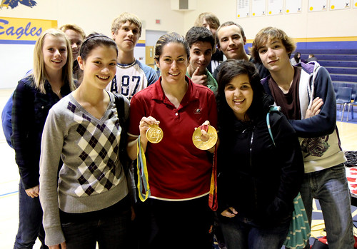 Katie Weatherston displays her Olympic Gold Medal and her World Championship Gold Medal with DHS students.