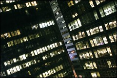 After Hours, Financial District (Linus Gelber) Tags: city nyc windows urban newyork architecture night buildings lights downtown nightscape manhattan bynight financialdistrict business citylights offices whitehallstreet newyorkbynight bridgestreet businessdistrict canon28135mmisusm gsubby122109