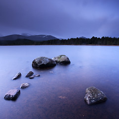 Loch Morlich by Moonlight (dougchinnery.com) Tags: longexposure pink blue winter copyright moon lake snow ski mountains water clouds sunrise square dawn rocks moody skiing cloudy fineart crescent crop moonlight cropped aviemore cairngorm cairngorms lochmorlich thefatcat44 dougchinnery