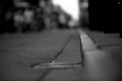 Asphalt memories (.I Travel East.) Tags: road street bw monochrome mono nikon louisiana dof bokeh neworleans streetphotography asphalt curb crescentcity nawlins thebigeasy royalstreet frenchquarters neworleanslouisiana d700 nikond700 asphaltmemories