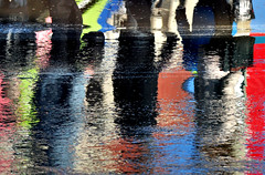 Reflections on the street (Jan_ice) Tags: reflection street wetpavement peoplereflected colourful
