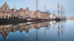 Smooth Sailing (McQuaide Photography) Tags: haarlem noordholland northholland netherlands nederland holland dutch europe sony a7rii ilce7rm2 alpha mirrorless 1635mm sonyzeiss zeiss variotessar fullframe mcquaidephotography lightroom adobe photoshop tripod manfrotto light licht bluehour twilight schemering water reflection stad city urban waterside lowlight architecture outdoor outside waterfront building longexposure winter river spaarne donkerespaarne riverside pegasus boat ship schip boot zeilboot sailboat traditional authentic wideangle groothoek skyline house residential smooth calm peaceful tranquil