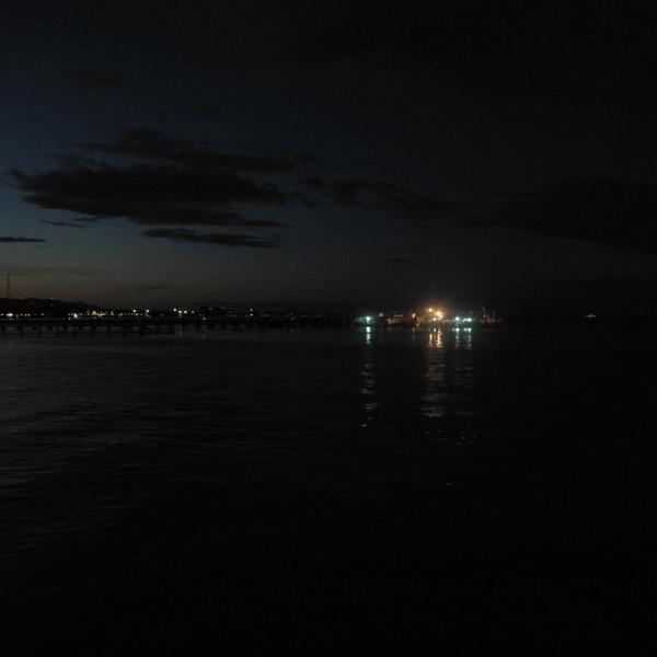 Night falls into the sea