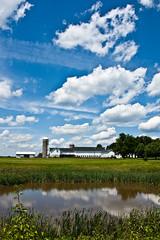 Clouds over Kerr's Farm (nosha) Tags: blue summer sky nature water beautiful beauty clouds rural reeds landscape newjersey pond nikon pattern farm nj july silo mercer f80 2009 korn kerr mercercounty kerrs lightroom 18mm blackmagic nosha 0ev 18200mmf3556 1500sec nikond40 kerrsfarm kornstand 1500secatf80 ul20090719