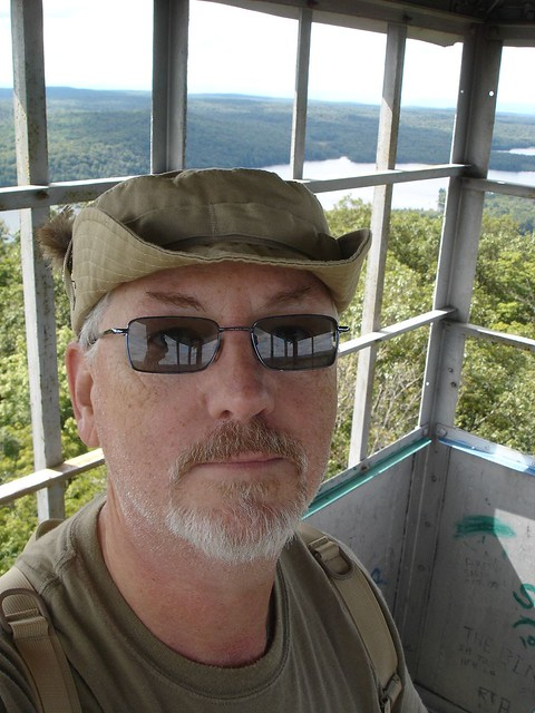 Atop a fire tower in the Adirondacks, New York.