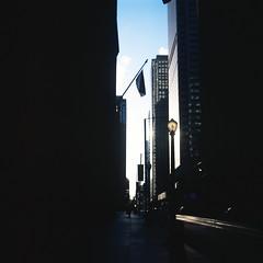 .. (Js) Tags: blue sky 6x6 clouds mediumformat square fuji shadows empty financialdistrict negative velvia lamppost level distance yashica emptiness underexpose rvp mat124g adelaidestreet streel iso50 sidewalt