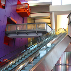 Escalators at the Lowry Theatre, Salford (paul_burdon) Tags: square purple escalator salfordquays escalators salford lowrytheatre