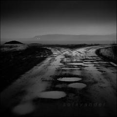 Lonely road ( Where do we go from here? ) (solavander) Tags: autumn blackandwhite bw white black monochrome rain square landscape geotagged blackwhite iceland nikon natur regn d3 wether hst isl kveld 500x500 2470mmf28 belysning explored vr regnvr dagslys rstid winner500 solavander geo:lat=64329945 geo:lon=21664696