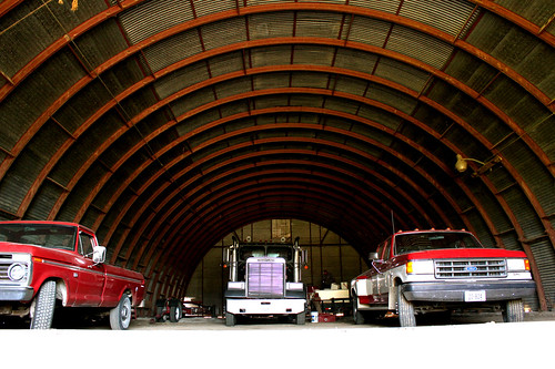 The grain truck and pick-up about to leave their winter home in the shed.