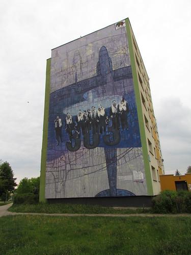 Justyna Dziechciarska - mural painting; at 3 Dywizjon 303 St.