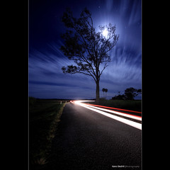 Moon Up | Moon Down; We're always on the move. ([ Kane ]) Tags: road longexposure trees moon tree cars lines car night clouds rural dark stars australia brisbane qld queensland late kane longexp gledhill 50d moonclouds yatala karmapotd alemdagqualityonlyclub kanegledhill kanegledhillphotography
