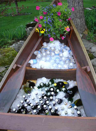 The boat and wagon can be rented at Vermont Wedding Props beverage display3