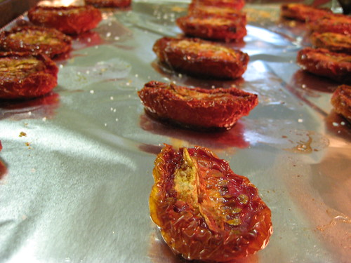 oven roasted tomatoes on baking sheet