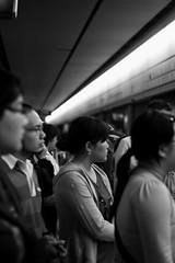 Waiting. (Gemma Maree) Tags: light people blackandwhite girl subway hongkong asia crowd transport kowloon