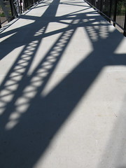 Shadows on the old railroad bridge across the ...