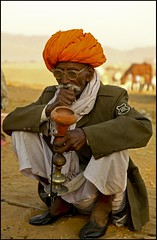 The Chillum Smoker (Hema Narayanan) Tags: pushkar rajasthan gettyimage camelfair thardesert pushkarcattlefair pushkarfair2009 pushkarfestivalof2009 cattlefairatpushkar gettyimageselected