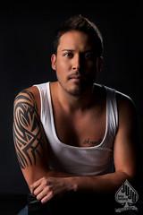 leo (juju~in~austin) Tags: tattoo angel austin nikon leo handsome tanktop stare d200 johnnydepp browneyes wifebeater malemodel latinmale artgirlnyc jujufotofactory