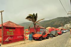 Arraial do Cabo - RJ (meeeeeeeeeel) Tags: riodejaneiro rj arraialdocabo street streetshot streetscene cars red vermelho cloudy nublado brasil brazil braziliancity cidadebrasileira regiãodoslagos