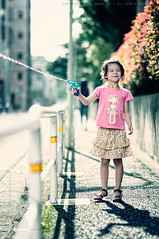 Ami Get Your Gun: Omori, Tokyo (Alfie | Japanorama) Tags: road street pink summer playing cute girl japan naughty japanese tokyo nikon pretty gun dof bokeh daughter young sunny cheeky ami eurasian waterpistol omori mixedrace locale mischievious d300 ourneighbourhood anglojapanese nikkor85mmf14afd