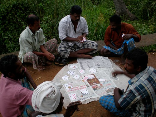 Guys illegally playing cards for money