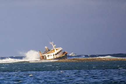 Fishing boat grounded on Mulinuu reef