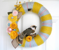 Yellow and Blue Yarn Wreath (KnockKnocking) Tags: pink flowers autumn brown bird fall love nature rose yellow vintage cozy berry soft pretty nest sweet outdoor handmade unique pastel cottage decoration stripe mother feather felt spray yarn wreath ornament finch round mustard chic millinery shabby yarnwreath knockknocking agnesblum