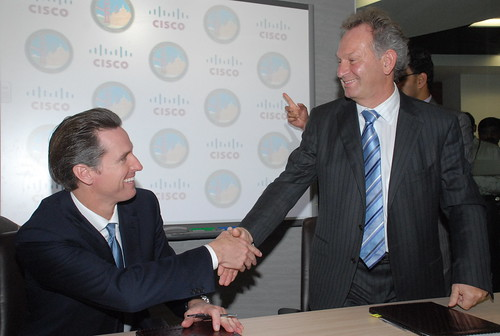 San Francisco Mayor Gavin Newsom and Wim Elfrink, Cisco chief globalisation officer and EVP, Cisco Services, sign agreement in principal in Bangalore, Dec 1st 2009