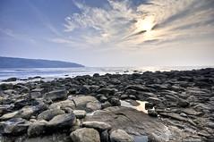 Hedvi Beach! (recaptured) Tags: blue sea sky sun water clouds rocks stones sigma dynamicrange 1020 ultrawide tranquil hdr arabiansea recaptured ultrawideangle nikond90 amitsharma recapturedin