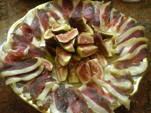 The duck prosciutto presented with fresh figs as an appetizer for Christmas dinner.