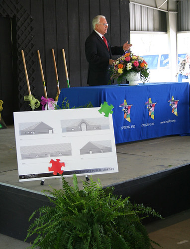State Director Fern with drawings of the new library building.