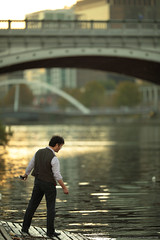 Fishing: The Economical Method - IMG_3400 (genotypewriter) Tags: sunset man water river fishing waves availablelight fineart australia melbourne tuxedo yarra vest tux dressed waistcoat angling princesbridge noreel nopole vestee canonef200mmf2lisusm exquisitar