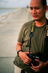 55480036 (Nasey) Tags: portrait people slr film beach nikon slide malaysia fujichrome yashica d3 terengganu velvia50 carlzeiss kualaterengganu 50mmf17 rvp50 planart fx3super2000 nasey kupih nasirali hafizahmadmokhtar kampungladang