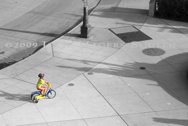 colorful young boy riding bike at Olympic Sculpture Park