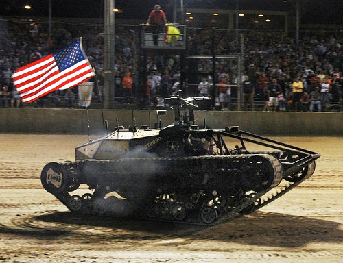 Darrell Waltrip does donuts in the Army technology demonstrator the Ripsaw MS2 at Prelude to the Dream race at Eldora Speedway in Ohio Sept. 9, 2009.