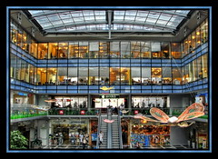 A mall in Prague (Mike G. K.) Tags: windows roof people signs glass mall shopping geotagged lights prague decoration symmetry shops czechrepublic hdr offices butteflies 2exp photmatix geo:lat=5007541 geo:lon=14418451