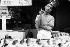 Fishy (Noa Ka) Tags: world street camera city portrait people blackandwhite bw streets art portraits photography israel photo blackwhite fuji faces market photos jerusalem capital human fujifilm sales seller salesman s5700