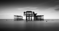 Brighton Old Pier standing alone (Nathan J Hammonds) Tags: brigton old pier sussex monochrome blackwhite nikon d750 nd 10stop standingalone calm long exposure sea coast structure architecture buildings