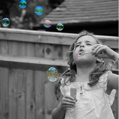 Bubbles, bubbles, bubbles ..... ( Angel of light ) Tags: uk family summer colour girl angel children toys seasonal bubbles blowing pop popped selective tweet twitter familyuk light2009 angeloflight2009 whatgettywants familygetty2010 gettyimagesportraits summertimeuk