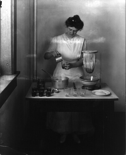 Demonstration of making rhubarb jelly. Photo taken by Troy in 1916 for Miss Canon