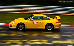 Yellow Porsche GT3 @ Nurburging (Mishari Al-Reshaid Photography) Tags: auto blur cars sports car yellow race speed canon germany moving automobile track awesome wheels fast german porsche autos panning canondslr canoneos automobiles kuwaitcity sportscar carphotos carphotography gt3 nurburgring coolcars gtm carphoto canoncamera canonphotos canoneflens porschegt3 canonllens 40d mishari kuwaitphoto kuwaitphotos canoneos40d canon40d kuwaitcars kvwc kuwaitartphoto gtmq8 kuwaitart kuwaitvoluntaryworkcenter kuwaitvwc canonef7020028is kuwaitphotography misharialreshaid malreshaid misharyalrasheed