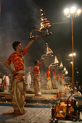 Ganga Aarti (sparkeypants) Tags: show travel boy india man night standing canon geotagged asia indian performance ceremony entertainment nighttime varanasi banaras benaras uttarpradesh gangaaarti earthasia unseenindia lpentertainment lp2011winners