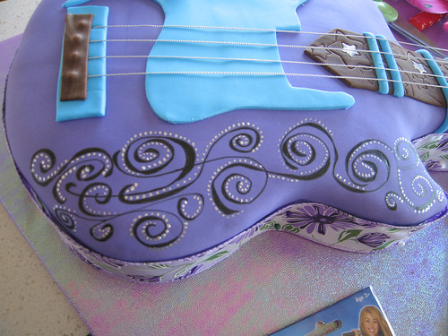 Guitar Cake Step 5 - Adding decorations and handpainting designs