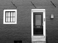 (...uno che passava... (senza ombrello)) Tags: bw amsterdam bn porta finestre bncitt
