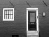 (...uno che passava... (senza ombrello)) Tags: bw amsterdam bn porta finestre bncittà