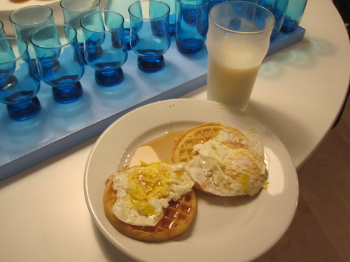 Eggs, waffles, maple syrup,  milk