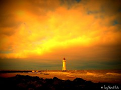 Sunset at New Brighton Lighthouse, (Tony Worrall Foto) Tags: uk light sunset sea england beach nature sunshine weather clouds danger liverpool warning fire golden seaside rocks view natural northwest scenic birkenhead shore lit sunlit seashore attraction fireinthesky wirral newbrighton redskyatnight merseyside scouse newbrightonlighthouse perchrocklighthouse