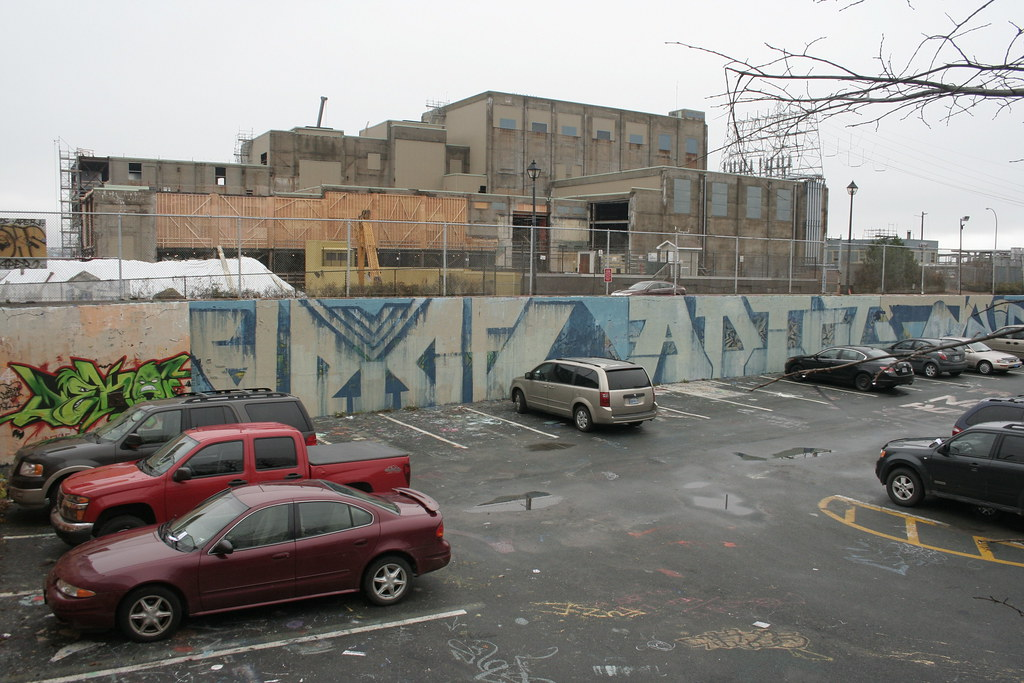 The Pit: parking lot and former legal wall. NSP offices under construction in the background.