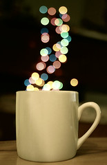 Hot Cup of Coffee (explored) (Donna Irene.) Tags: christmas winter holiday hot color cup coffee closeup season happy lights focus colorful december drink bokeh circles joy beverage steam christmaslights depthoffield mug cheer jolly unfocused celebrate