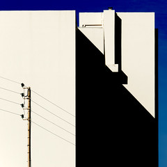 Electricity, Juan-les-Pins, 2008 (Gianni Galassi) Tags: city light shadow urban blackandwhite bw abstract france building architecture square concrete casa blackwhite graphics shadows balcony patterns fineart ombra perspective minimal diagonal blank urbano void cemento minimalismo francia architettura antibes bianconero biancoenero grafica quadrato dechirico balcone diagonale prospettiva elettricit juanlespins balaustra vuoto metafisica 500x500 justimagine electricpower giannigalassi winner500