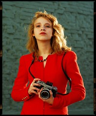 Young Woman in Red with Nikon (Studio d'Xavier) Tags: camera red portrait paris rot crimson fashion rouge rojo nikon style 8x10 chic hautecouture nikonf2 chanel rood 2009 reddress vermillion waistlevel cocochanel   redforthepeopleofburma  nikkor50mm18 thechanelsession